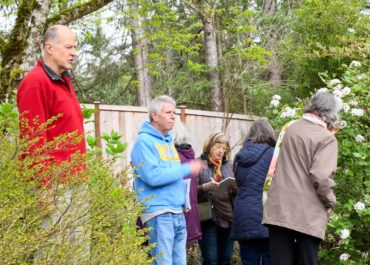 Garden tour participants spend time with Hinkley as he identifies the plants and tells stories about many of them.