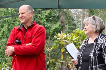 Dan Hinkley, director, and Marcia Brixey, volunteer tour coordinator, greet participants at the beginning of the private Heronswood tour.