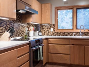Red Oak-three-quarter-overlay face-frame, cabinets with finger pulls