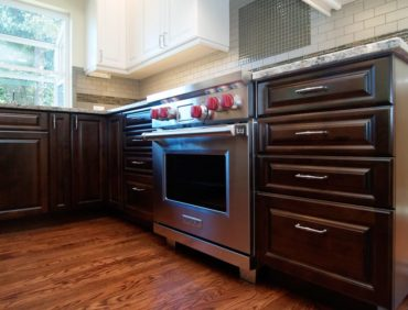 Frameless cabinets with full-overlay, raised- panel doors and drawers and light valance on wall cabinets
