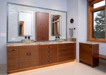 Contemporary, book-matched mahogany cabinets with slab doors and drawers