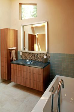 Wall-hung vanity and linen cabinet with touch-latch hardware