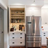Linen white painted cabinetry with a custom-configured storage cabinet