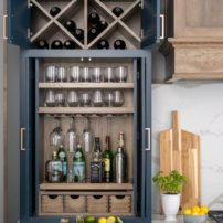 Customized bar behind entertainment-style doors (Photo courtesy Dura Supreme Cabinetry)