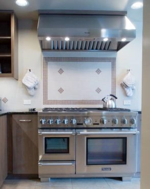 Freestanding professional range with convection oven, steam oven, warming drawer, six burners and griddle (Photo courtesy A Kitchen That Works, LLC)