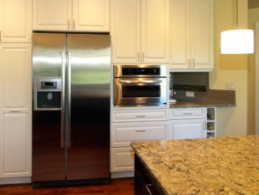 Side-by-side refrigerator and built-in convection microwave oven (Photo courtesy A Kitchen That Works, LLC)