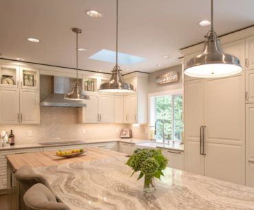Built-in, panel-ready — refrigeration, freezer towers and chimney-style ventilation hood (Photo courtesy A Kitchen That Works, LLC)