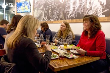 A group sampling the food to host an upcoming event