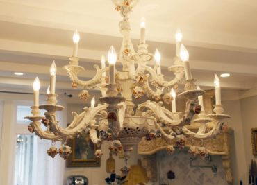 The centerpiece of the kitchen is the Capodimonte chandelier.