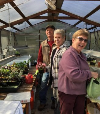 Paul Weisdepp, Ann Maughan and Elizabeth Haycock in the propagation greenhouse