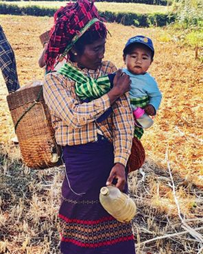 Mother and child working in the fields outside of Kalaw