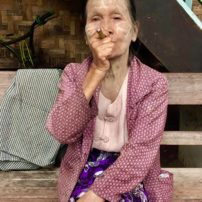 Old women smoke cigars in Myanmar, usually hand-rolled.