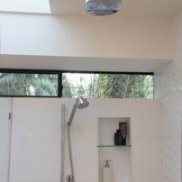 Skylight keeps bath and curbless shower bright