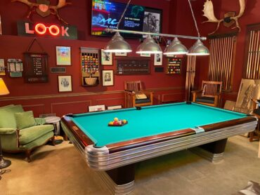 Smalley's garage features a 1945 Brunswick 9-foot billiards table, a sign from the '20s from the Crow's Nest Tavern; a 1940s jukebox from the Pearl Maurer dance hall and Leonard, the movie theater ticket-taker from Bremerton's Roxy Theatre.