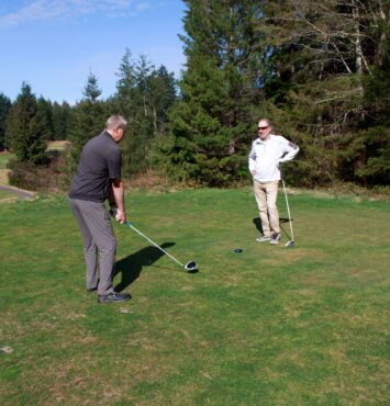 Golfers Steve Decoy and Frank Horton playing at Gold Mountain