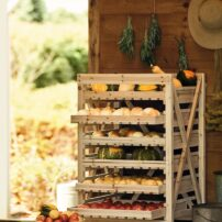 Wooden orchard racks maximize storage space, while allowing air to reach each layer of produce. (Photo courtesy of Gardener's Supply Company)