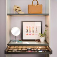 Make-up table with TAG Hardware illuminated glass shelf