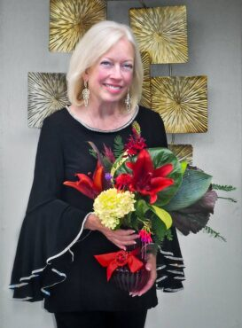 Dee Coppola (Photo courtesy Winifred Whitfield, Flower arrangement Courtesy Susan Crossland)