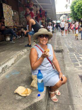 Enjoying samosas at the Port Louis market