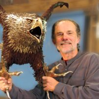 "Gary Jackson with eagle. This photo appeared in the fall 2009 issue of WestSound Home & Garden magazine's ""An Art-full Weekend"" — a feature about the Gig Harbor Open Studio Tour. Due to COVID-19 restrictions, the event was canceled for 2020, which would've marked the 28th year of the tour. (Photo courtesy Charlee Glock-Jackson, 2007)"