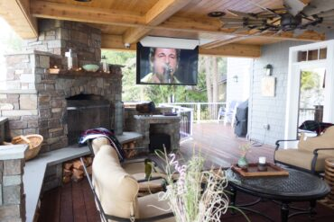 Outdoor entertainment area complete with a 65-inch, motorized, flip-down, high-definition screen and home-theater surround system.