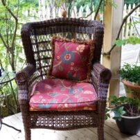 Wicker chair on covered porch