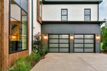 "Eileen Black, a realtor with John L. Scott Real Estate Bainbridge Island, said this style of garage door is contemporary looking ""but not in a way that makes the home too modern looking ... It just pulls it into the 21st century. It can really make a house stand out."" (Photo courtesy Kitsap Garage Door)"