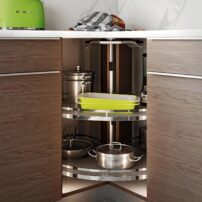 This Lazy Susan is a corner unit with added technology. The doors fold back inside the cabinet and spin around with the trays, and close automatically when returning to the front. There is an adjustable rotational speed, offering complete customization.