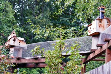 Fanciful birdhouses, created by Jim McIntyre, decorate the cat ramp that leads to the McIntyres' cat enclosure. <em>(Photo courtesy Luba Fetterman)</em>