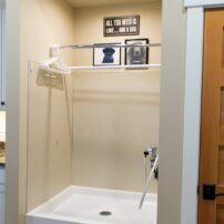 """Raised-level dog shower in Mark and Gail Westin's mudroom make it easy to """"clean up"""" Daisy."""