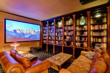 Nuts About Hi-Fi installed a home theater system using Screen Innovations 128-inch high-definition screen along with a JVC 8K projector.