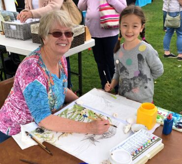 Kathy Thurston painting at the Gig Harbor Farmers Market