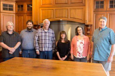 From left to right: Michael Scheurich, design/sales; Ben Muhleman, design/sales; Howie Hulst, design/sales; Cindy Friend, design/sales; Tess Moore, owner; Brad Moore, design/sales/owner