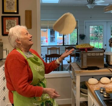 Barb Bourscheidt playing with a pizza crust