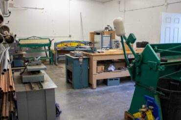 Inventory warehouse with a custom metal fabrication section