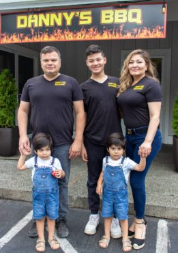 Left to right: Juan Fimbres, son Juan Jr., wife Yadhira, twin sons Max and Dan at the family business, Danny's BBQ